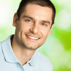 Handsome young smiling man, outdoor