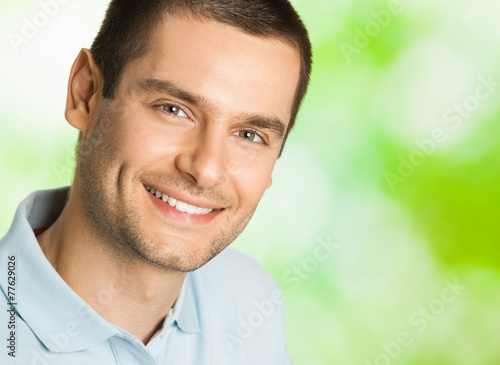 canvas print picture Handsome young smiling man, outdoor