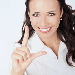 Businesswoman showing two fingers, on grey
