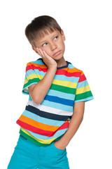 Upset little boy in a striped shirt
