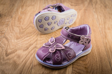 pair of baby shoes on a  wooden background