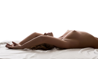 Studio portrait of sensual topless woman lying