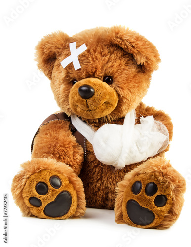 Leinwanddruck Bild Teddy with bandage