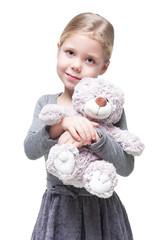 Beautiful little girl with teddy bear isolated