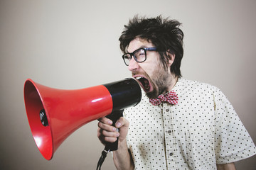 Nerdy guy with megaphone