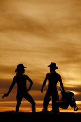 silhouette of woman cowboy hat with gun down