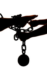 silhouette womans legs ball and chain with hands