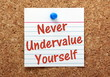 Never Undervalue Yourself reminder on a notice board