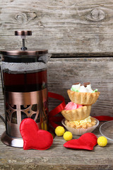 Cup of tea, cakes and red hearts