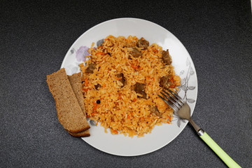 Plate of pilaf on white on a table