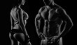 Bodybuilding. Strong man and a woman posing on a black backgroun - 77637094