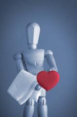Wooden waiter serving red heart.