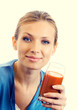 Portrait of young woman with glass of tomato juice