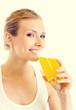 Portrait of young woman in fitness wear drinking orange juice
