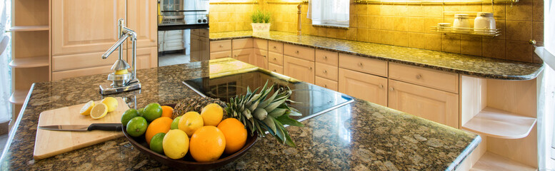 Marble island inside expensive kitchen