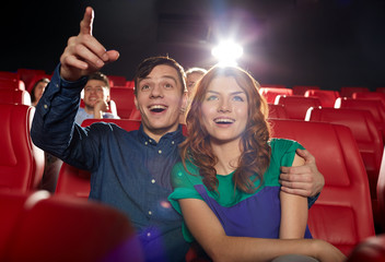 happy friends watching movie in theater