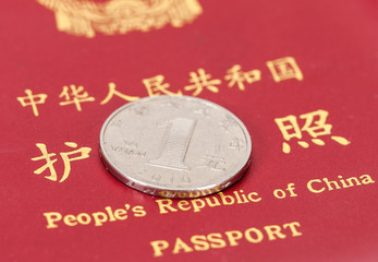 Chinese one yuan coin against the background of the Chinese pass