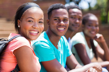 female african college student with friends on campus