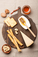 Assorted cheese,  grissini bread sticks, honey and nuts