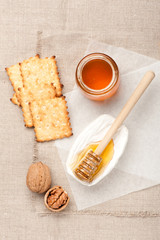 Camembert cheese, honey, cookies and nuts