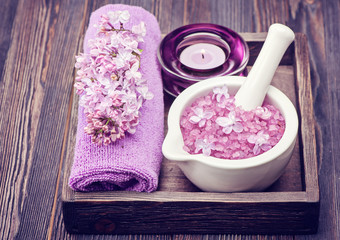 Spa sea salt in mortar and lilac flowers. Spa.