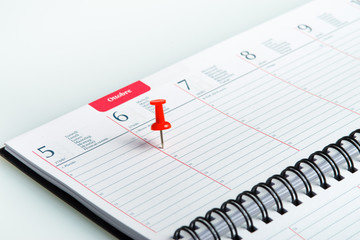 weekly agenda with spiral and red pin