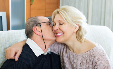 Portrait of loving mature spouses