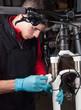 Mechanic doing the maintenance of a bike