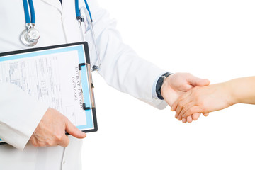 Doctor shaking a woman hand in greeting or congratulations at a