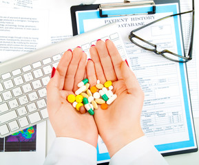 Different tablets, pills, in woman hands