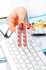 tablets, pills, in woman hand