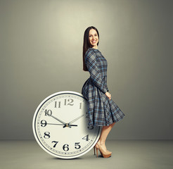 young woman sitting on a clock