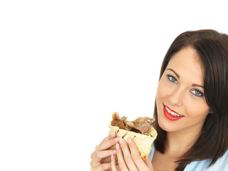 Young Woman Eating a Donner Kebab