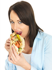Young Woman Eating Chicken Kebab with Salad