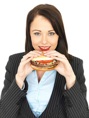 Young Business Woman Eating a Beef Burger