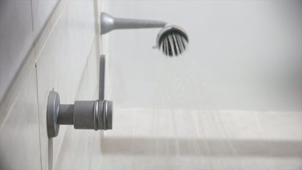 Woman Taking A Shower Closeup Of Water Tap And Wet Feet