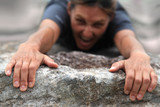 Rock climber holding on