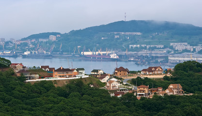 Houses on the background of the port of Nakhodka.