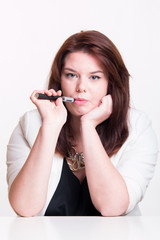 Woman smoking e-cigarette on a white background