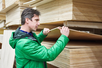 Man shopping for plywood in shop