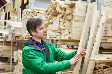 Man shopping for timber in DIY shop