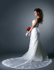 Studio photo of majestic bride in elegant dress
