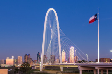 Dallas downtown skyline with Margaret hut hills bridge at night