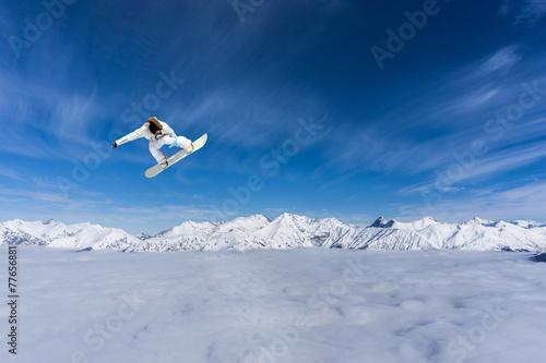 Fototapeta Flying snowboarder on mountains