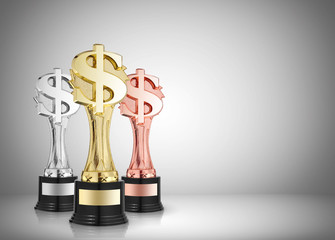 golden,silver and bronze dollar sign trophies on gray background