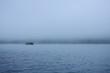raft float on river among mist