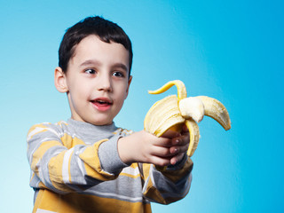Five years old boy who shooting with banana