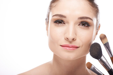 Woman with make-up brushes