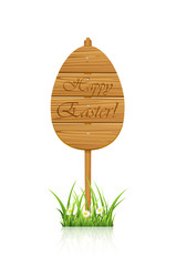 Wooden Easter sign in a grass
