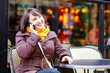 Young girl talking on thephone in Parisian cafe